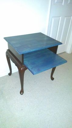 Small TV stand for computer desk. 3 shades of blue on the top and pull out, legs and bass are cherry wood.