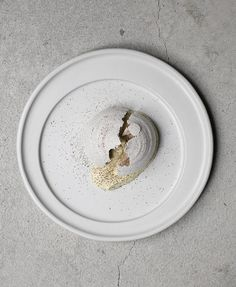 This savory Corn Husk Meringue and Corn Mousse dessert is by Mexican chef Enrique Olvera and featured on the menu of his New York City restaurant, Cosme.