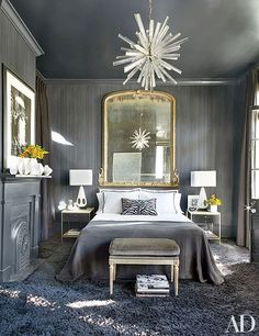 AD100 talent Lee Ledbetter designed this handsome New Orleans guest room, which features vintage bedside tables, a velvet-clad Louis XVI–style bench, and a dazzling Art Deco fixture.