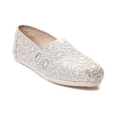 Step into the shimmery style of the new Classic Glitz Slip-On Shoe from TOMS! These glistening Classics flaunt a sophisticated glittery upper and charming crochet overlay.     <br><br><u>Features include</u>:<br>  > Textile upper with glitter finish and crochet overlay<br>  > TOMS toe-stitch and elastic V for easy on and off<br>  > Removable, antimicrobial sock liner<br>  > Rubber outsole delivers flexible traction<br>