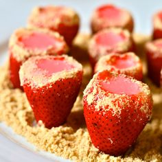 Strawberry Cheesecake Jello Shots...2 large containers strawberries, 1 small package of strawberry jello, 1 cup water, 8oz cream cheese, room temperature, 1 cup vanilla or whipped cream vodka, chilled (or regular vodka plus 1 teaspoon vanilla extract), crushed graham crackers for garnish...