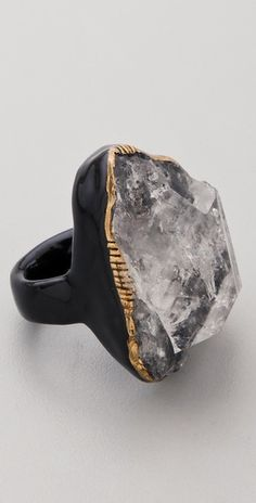 """Adina Mills.........Connie Fox: Contrast between """"icy"""" appearing quartz stone and black setting. Copper appearing rim around the stone offers a little more contrast."""