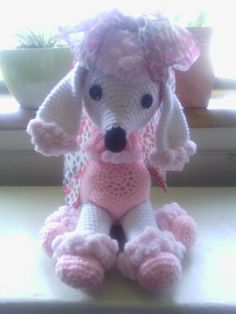 This is my *Rosita* Pomp-a-doodle that I made for my Mom. I saw this pattern on RedHeart.com and fell in love with her. Here is the pattern: http://www.redheart.com/free-patterns/pomp-poodle