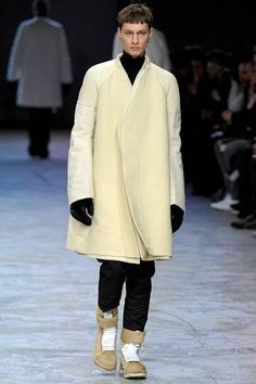 An AMAZING pale yellow swing coat from Rick Owens. LOVEIT NEEDIT WANTIT!!! A+++