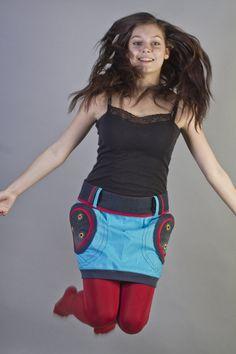 """Sukně """"Cyan 3"""" Originální, veselá, hravá sukně, navržená v kombinaci plátna, džínoviny a úpletu. Na džínových kapsách zdobená dírkováním s ručním obšitímv několika barevných odstínech. Sukni doporučuji nosit spadlou na boky.Zapínání vzadu na zip a 2 knoflíky. Sukně je přes boky volná, takže se přizpůsobí různým postavám. Velikost na objednání - ..."""
