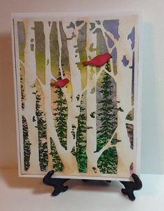Tim Holtz birch trees die over color burst background. Tree stamp is from SU Wonderland