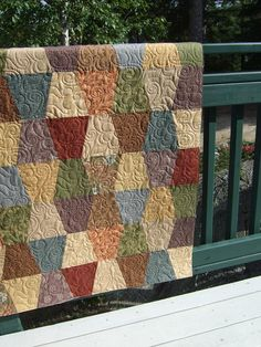 Love these colors, the geometric shapes and very organic and flowing quilting...great combination.