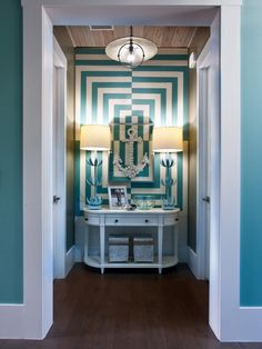 High-regency style is best expressed in the foyer alcove, a niche that connects foyer to master suite and boasts a wall treatment inspired by chic hotel interiors.