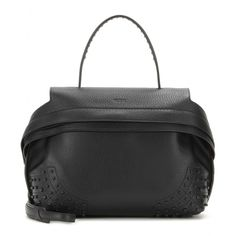 Tod's - Leather tote - In its timeless black hue, this tote from Tod's looks chic no matter what the season. In grainy leather with tonal studs and a clean silhouette, it'll prove an easy essential. Style with pumps and silk after dark. seen @ www.mytheresa.com