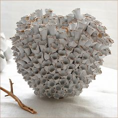 Tozai Home Round Barnacle Vase : Tozai Home Barnacle Vase. Intricate detailing makes this interesting vase a must-have. Towering seashells form a unique sculpture that will ad a focal point to a seaside decor. Round vase measures 12