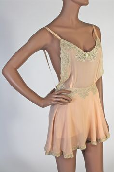 1930's Backless Teddy with open bodice, skirted tap pants, with modesty flap front and back. Central bodice floral appliqué and trimmed with French lace.