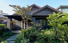 Splinter Society have designed the modern interior renovation of a Californian bungalow in Melbourne Indoor Outdoor Living, Outdoor Living Areas, Bungalows, Stepping Stone Paths, California Bungalow, Bungalow Renovation, Australian Architecture, Residential Architecture, Landscape Architecture