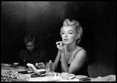 Marilyn Monroe at her vanity doing her makeup--I have this painting above mine :)