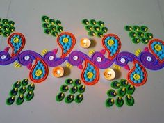 Beautiful peacock rangoli border design by DEEPIKA PANT - YouTube