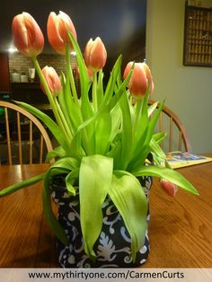 "I love this beautiful display of tulips in a Thirty-One Gifts ""Little Carry All Bin"".  How cute is that?  Perfect for a birthday gift or just to cheer someone up.  Who wouldn't like that?  http://www.mythirtyone.com/CarmenCurts/"