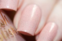 Nude pink cream featuring color shifting flakies!