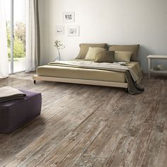 Floor tile that looks like wood-- orchard grey. (Daltile) 12x48, 8x48, 6x48, staggered pattern.