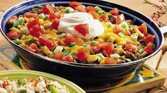 16 0z Macaroni 1lb of Extra Lean Hamburg 1/2 Cup Chopped Onion 1 Can (15oz) Black Beans 1 Can (14.5 oz) Diced Tomatoes, undrained  1 Cup Kernel Corn 1 Cup Thick n'Chunky Salsa 1 Pkg Taco Seasoning 11/2 Cups of Colby Jack Cheese 1/2 Cup Sour Cream  Prepare Elbows, drain  Fry hamburg, onions, drain  Stir in beans, tomatoes, corn, salsa, seasoning, and simmer for 5 minutes  Stir in 1 Cup of Cheese, sour cream, and pasta.  Yum!