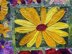 Detail of Applique Quilt - love the simplicity of the sewing lines on the petals