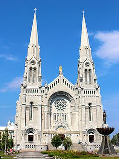 The Basilica of Sainte-Anne-de-Beaupré is a basilica set along the Saint Lawrence River in Quebec, Canada, 30 kilometres (19 mi) east of Quebec City. It has been credited by the Catholic Church with many miracles of curing the sick and disabled.