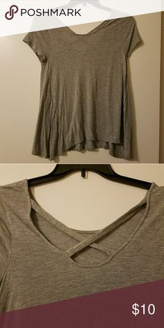 Heather grey criss cross back tee Heather grey tee with criss cross in the back. Smoke free and pet free home. Mossimo Supply Co. Tops Tees - Short Sleeve