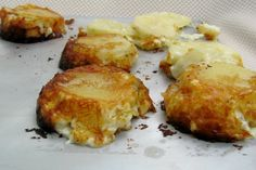 I saw Melissa make these on the Next Food Network Star show and wanted to try these for my family. Quicker baking time with the smaller portions. NOTE: I layered the potatoes, cheese, seasonings and onion several times and cooked it closer to an hour in my oven.