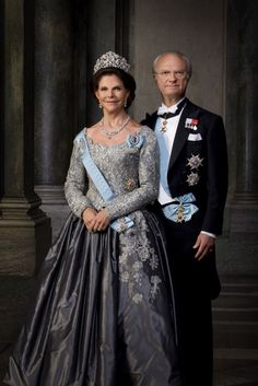 The King and Queen of Sweden wear the insignia of the Royal Order of the Seraphim with other decorations over evening formal attire.