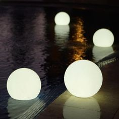 Floating, waterproof LED globes, provides a very neat look to the pool! This is … Floating, waterproof LED globes, provides a very neat look to the pool! This is better than candles for the pool Floating Pool Lights, Floating Globe, Floating Pool Decorations, Floating Balloons, Round Balloons, Floating Candles, Led Globe Lights, Light Globes, Ball Lights
