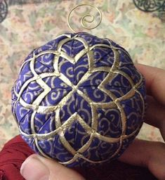 Here I offer a beautiful royal blue swirl fabric with gold lame. This is a tricky ornament to make as the lame is hard to handle. But the