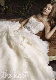 Gown features jeweled ribbon belt and organza petal accent.