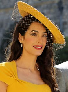 Amal Clooney wearing a yellow Stella McCartney dress to Harry and Meghan's royal wedding in 2018 dress, Amal Just Joined a Long and Iconic List of Celebrities in Yellow Dresses Amal Clooney, George Clooney, Wedding Fascinators, Wedding Hats, Royal Wedding Guests Outfits, Celebrity List, Celebrity Style, Vestido Multicolor, Wedding Makeup Tips
