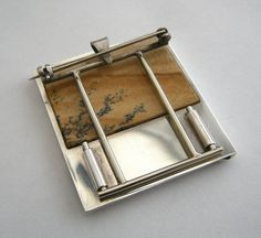Behind the Door    One of a series of silver brooches and pendants which I made using 'picture jasper'.  The back of the brooch was a particular challenge as I needed to fit the stone from behind. So, I made it removable. It's both a brooch and a pendant