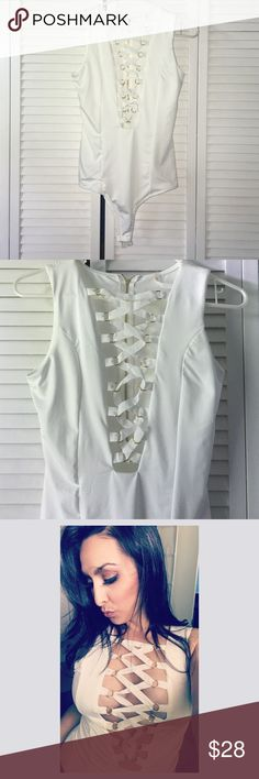 White front criss cross bodysuit ! White front criss cross bodysuit worn once !! Great condition ! With gold accents in front lace ! SZ medium ! Tops
