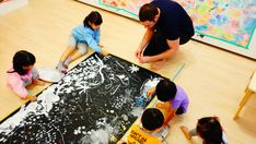 Children working together to create a unique piece of art