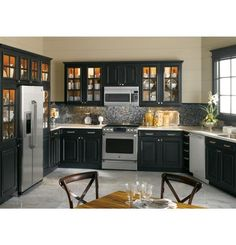 #GEfreshCO  Really love the stainless steel appliances with the black cabinets. The glass front doors give it more charm!