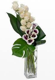 Image result for iris floral arrangements in cylinder vase