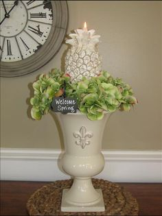 You'll love our Royal Street Urn! It's perfect for floral arrangements and chilling a bottle of wine. Here a collar of hydrangea blossoms surround a pineapple candle. The pineapple has served as a symbol of hospitality and warm welcome since early colonial times. Our Must-Have Mini Marker adds a touch of whimsy as we welcome Spring! Get this retired urn for $42.96 and you then qualify for a half-price item.  http://annslatter.store.willowhouse.com/product.aspx?zpid=5668