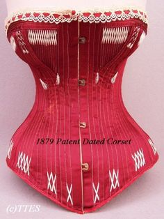 """Rare 1879 Patent Dated Red Silk Satin Corset  Lovely Cluny lace & silk floss trim, heavily boned, and marked """"PATENTED AUG. 31ST. 1879"""" and """"C2"""" with """"21"""" on an inner paper label. Metal eyelets and clasps. Shown with new lacing and with original laces included."""