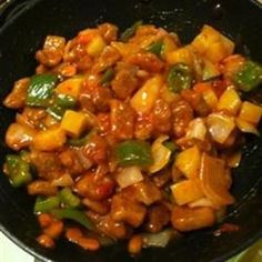"""""""This is a very popular dish in Singapore. Tender pork pieces combined with peppers, tomatoes, pineapple and onion in a sweet and sour sauce. I hope you will like it."""""""