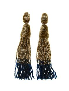 LONG OMBRE TASSEL EARRING - Oscar de la Renta $390.00 First spotted on the runway and a favorite among the fashion set, these long beaded tassel earrings are sophisticated and glamorous. Designed in New York and handmade in India, these statement makers are a beautiful addition to any wardrobe. For the ultimate statement, wear with the hair swept to the side.