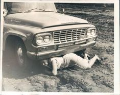Chicago woman crawls under police wagon during protest of school segregation. Photo is dated Aug 2, 1963.