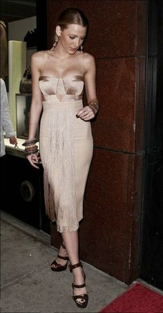 .Blake Lively looking lovely as usual in a little Versache number.