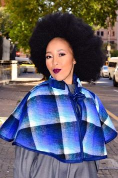 This poncho is made up of a traditional tswana blanket from basotho and batswana speaking south africans Sesotho Traditional Dresses, South African Traditional Dresses, Traditional Weddings, African Attire, African Wear, African Dress, African Clothes, African Fashion Dresses, Black Kids Hairstyles
