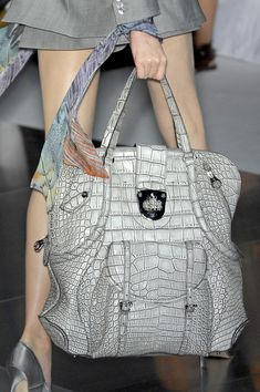 Alexander McQueen; pinned not for the purse...but for the idea of tying a cute scarf around the wrist with long sleeves - GREAT idea :)
