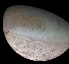 Pluto may look like Neptune's moon Triton (shown), possibly plucked from Pluto's neighborhood.