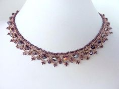 DIY Jewelry: FREE beading pattern for an elegant necklace made from bicone crystals and seed beads, woven into a beautiful lacy net.