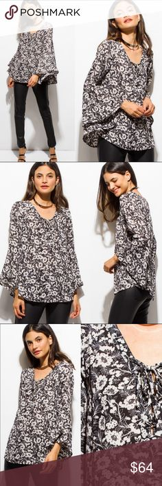 COMING SOON! Lace-up Floral Blouse Black and white blouse is flown and pretty. 100% polyester Add to a bundle for a private discount! Threadzwear Tops Blouses