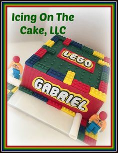 A theme that never gets tiresome!  Lego cake with fondant construction guys.   www.facebook.com/icingonthecake1