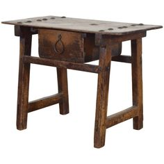 Spanish Baroque Pinewood Trestle Table with Large Iron Decoration, 17th Century | From a unique collection of antique and modern End Tables at https://www.1stdibs.com/furniture/tables/end-tables/.