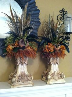 Old World look Candlestick Arrangements with feathers by Greatwood Floral Designs.